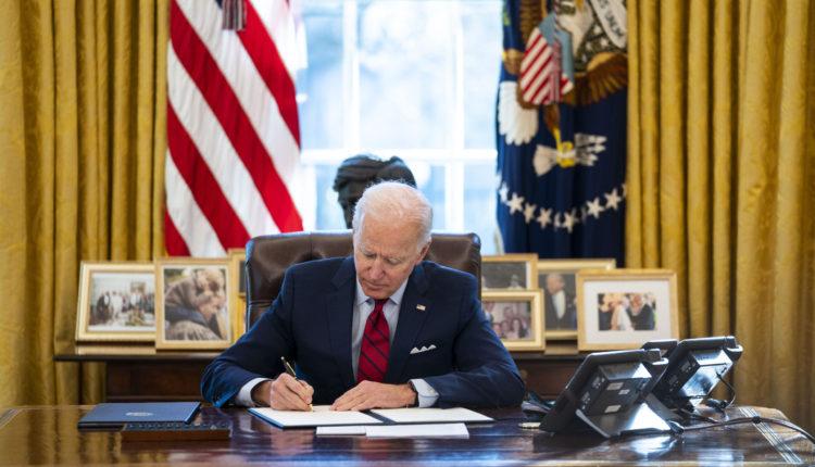 Biden-signing-1-scaled.jpg