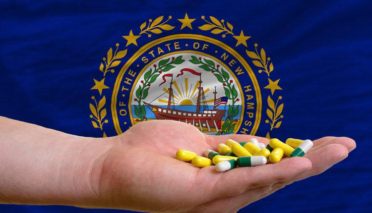 bigstock-Holding-Pills-In-Hand-In-Front-36659710.jpg